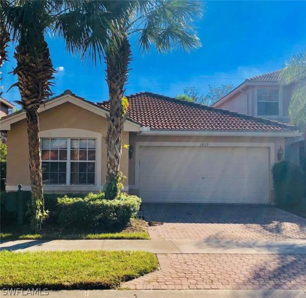 1619 Triangle Palm TER Naples, FL 34119 photo 2